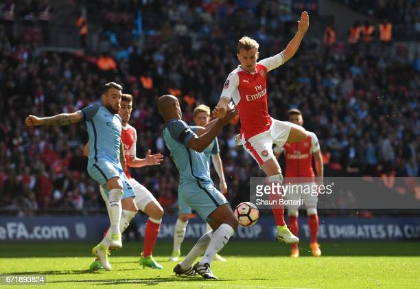 Rob Holding of Arsenal and Vincent Kompany of Manchester City compete for the ball during the Emirates FA Cup SemiFinal match between Arsenal and...