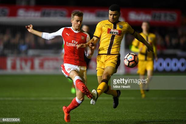 Rob Holding of Arsenal attempts to clear the ball under pressure from Maxime Biamou of Sutton United during the Emirates FA Cup fifth round match...