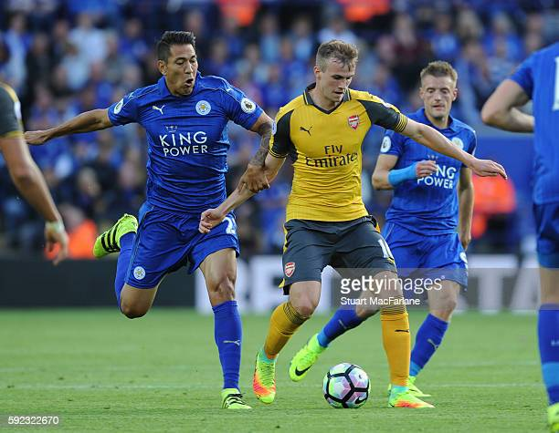 Rob Holding of Arsenal breaks past Leonarod Ulloa of Leicester during the Premier League match between Leicester City and Arsenal at The King Power...