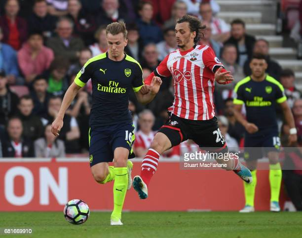 Rob Holding of Arsenal breaks past Manolo Gabbiadini of Southampton during the Premier League match between Southampton and Arsenal at St Mary's...
