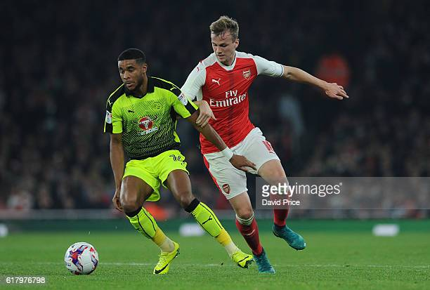 Rob Holding of Arsenal challenges Dominic McCleary of Reading during the match between Arsenal and Reading at Emirates Stadium on October 25 2016 in...