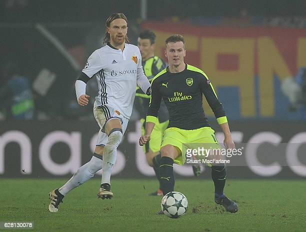Rob Holding of Arsenal challenges Michael Lang of Basel during the UEFA Champions League match between FC Basel and Arsenal at St JakobPark on...