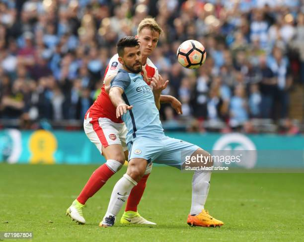 Rob Holding of Arsenal challenges Sergio Aguero of Man City during the Emirates FA Cup SemiFinal match between Arsenal and Manchester City at Wembley...