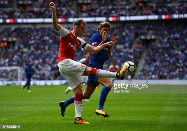 Rob Holding of Arsenal clears the ball while under pressure from Marcos Alonso of Chelsea during the The FA Community Shield final between Chelsea...