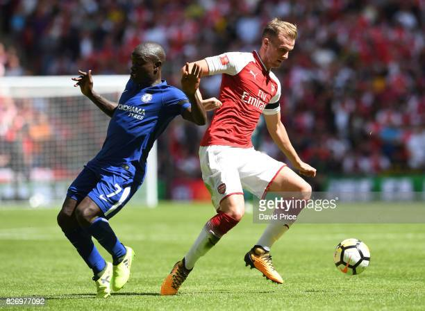 Rob Holding of Arsenal cuts inside N'Golo Kante of Chelsea during the match between Chelsea and Arsenal at Wembley Stadium on August 6 2017 in London...