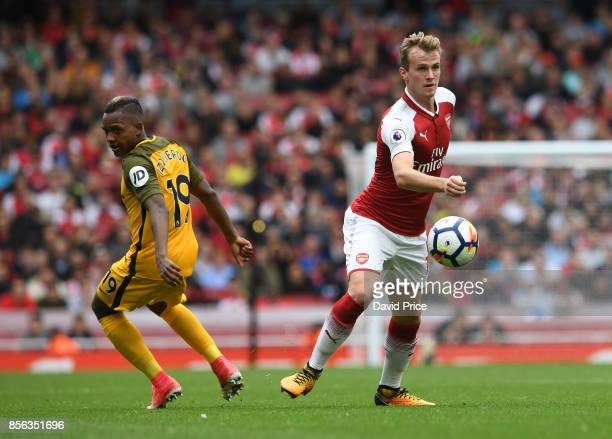 Rob Holding of Arsenal gets to the ball ahead of Jose Izquierdo of Brighton during the Premier League match between Arsenal and Brighton and Hove...