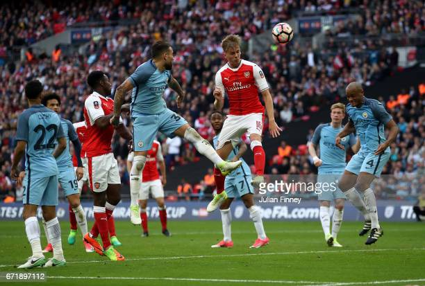 Rob Holding of Arsenal heads the ball during the Emirates FA Cup SemiFinal match between Arsenal and Manchester City at Wembley Stadium on April 23...