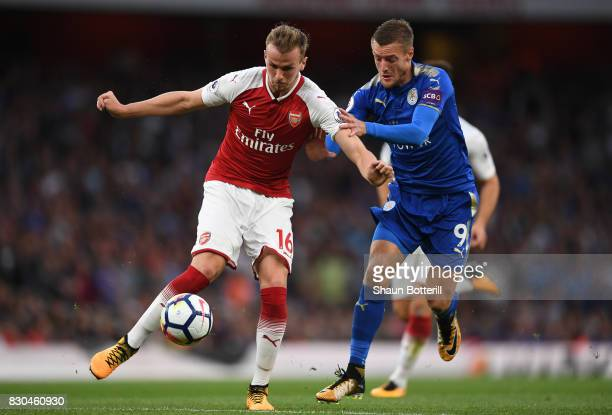 Rob Holding of Arsenal is challenged by Jamie Vardy of Leicester City during the Premier League match between Arsenal and Leicester City at the...