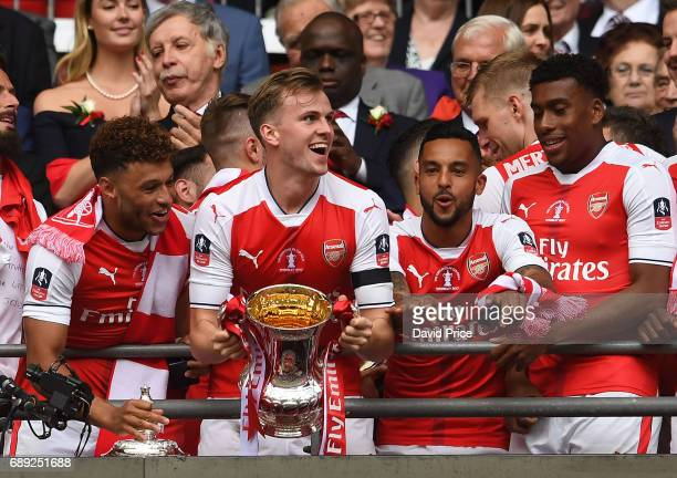 Rob Holding of Arsenal lifts the FA Cup Trophy after the match between Arsenal and Chelsea at Wembley Stadium on May 27 2017 in London England