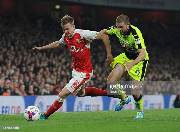 Rob Holding of Arsenal takes on Joey van den Berg of Reading during the match between Arsenal and Reading at Emirates Stadium on October 25 2016 in...