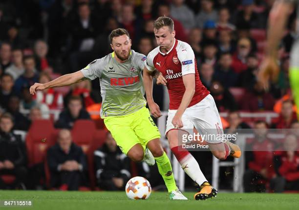 Rob Holding of Arsenal takes on Jorge Mere of Koeln during the UEFA Europa League group H match between Arsenal FC and 1 FC Koeln at Emirates Stadium...