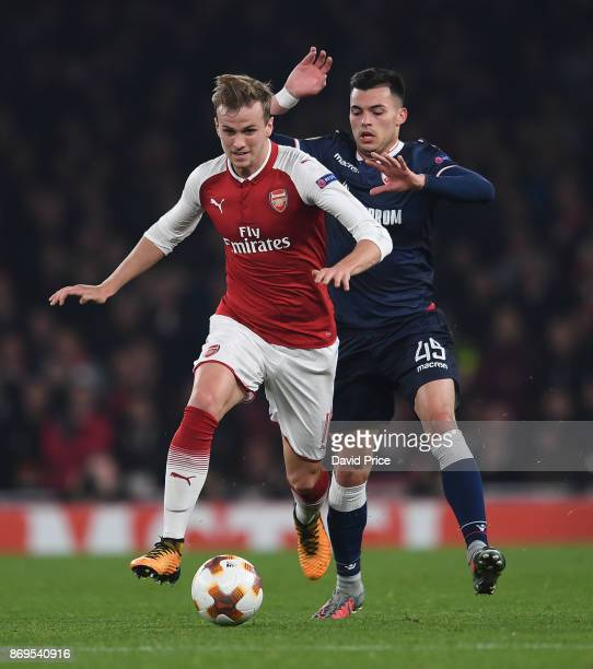 Rob Holding of Arsenal takes on Nemanja Radonjic of Red Star during the UEFA Europa League group H match between Arsenal FC and Crvena Zvezda at...
