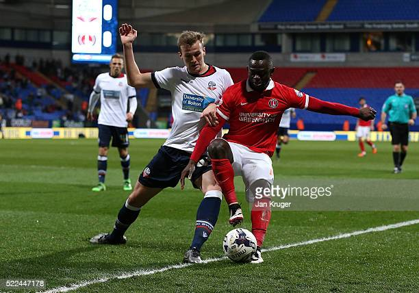 Rob Holding of Bolton Wanderers battles with Igor Vetokele of Charlton Athletic during the Sky Bet Championship match between Bolton Wanderers and...