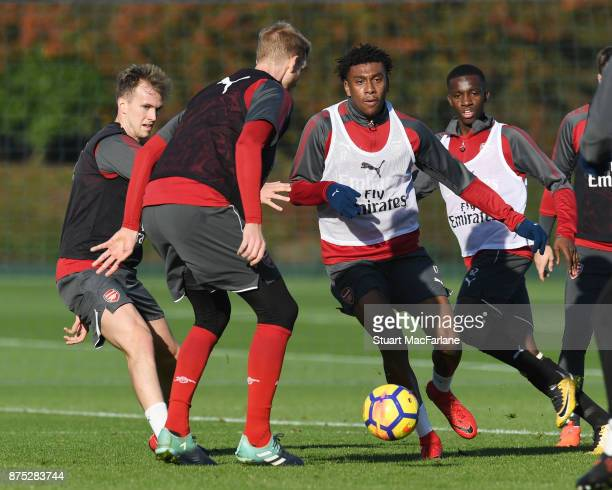 Rob Holding Per Mertesacker and Alex Iwobi of Arsenal during a training session at London Colney on November 17 2017 in St Albans England