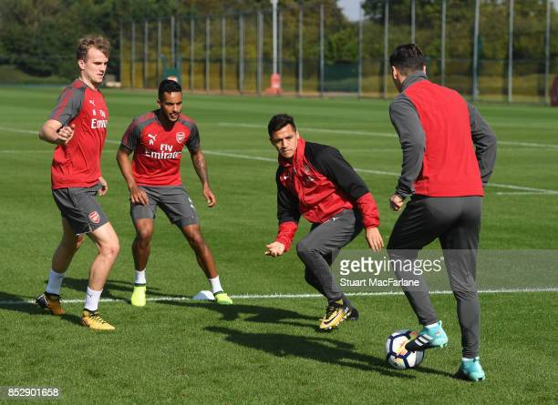 Rob Holding Theo Walcott Alexis Sanchez and Mesut Ozil at London Colney on September 24 2017 in St Albans England