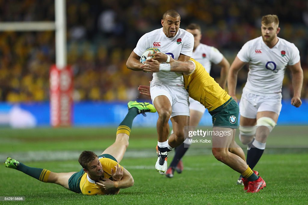 Rob Horne of the Wallabies misses a tackle on Jonathan Joseph of England during the International Test match between the Australian Wallabies and England at Allianz Stadium on June 25, 2016 in Sydney, Australia.