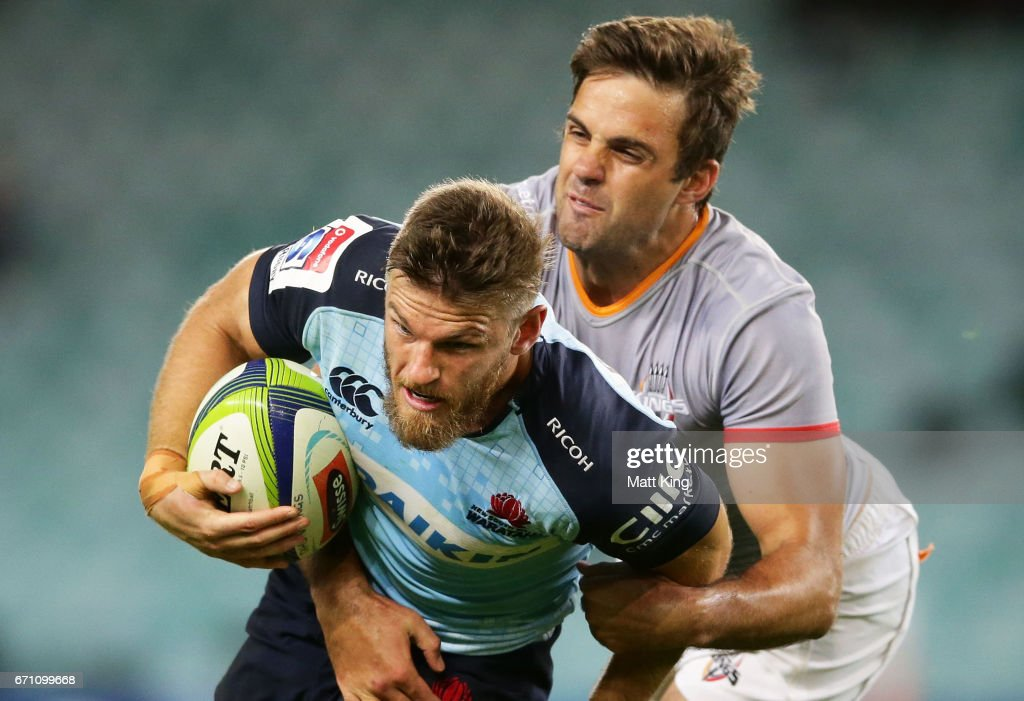 Rob Horne of the Waratahs is tackled by Nicolaas Hanekom of the Kings during the round nine Super Rugby match between the Waratahs and the Kings at Allianz Stadium on April 21, 2017 in Sydney, Australia.