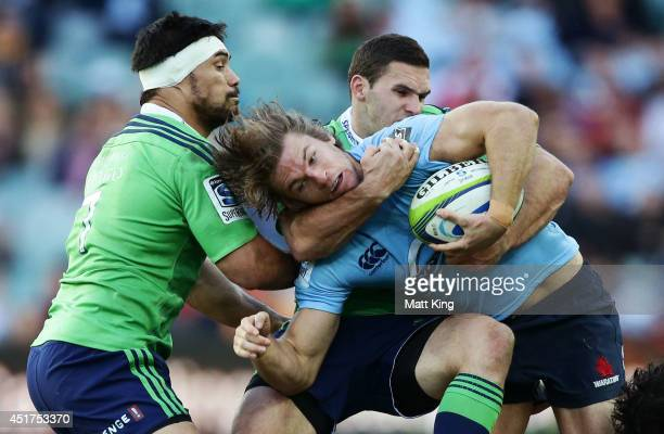 Rob Horne of the Waratahs is tackled during the round 18 Super Rugby match between the Waratahs and the Highlanders at Allianz Stadium on July 6 2014...