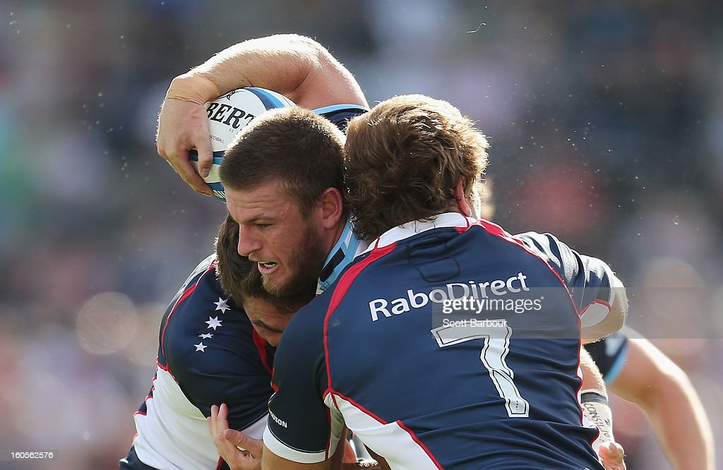 Rob Horne of the Waratahs is tackled during the Super Rugby trial match between the Waratahs and the Rebels at North Hobart Stadium on February 2, 2013 in Hobart, Australia.
