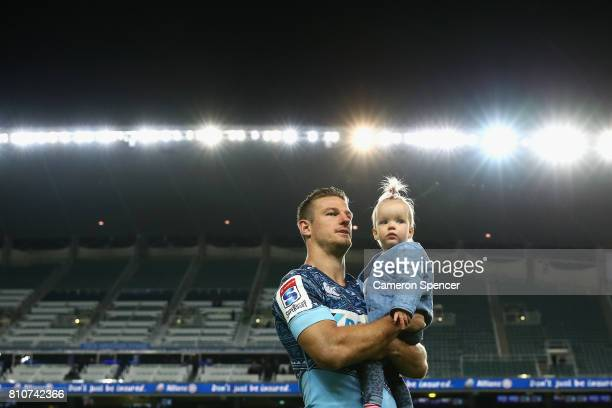 Rob Horne of the Waratahs walks onto the field with his daughter after playing his last home game for the Waratahs following the round 16 Super Rugby...