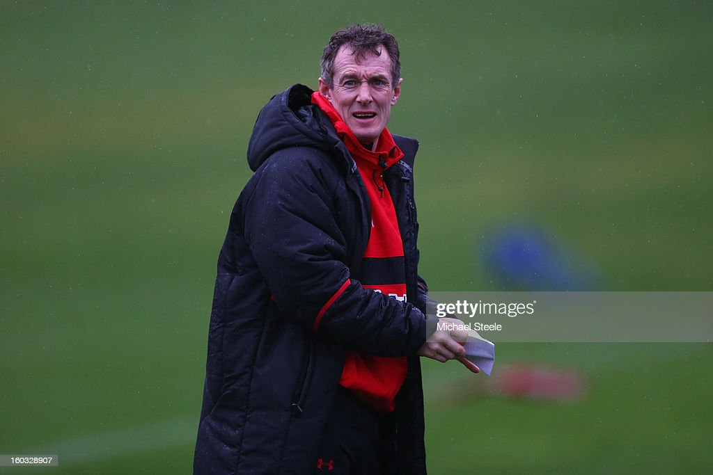 <a gi-track='captionPersonalityLinkClicked' href=/galleries/search?phrase=Rob+Howley&family=editorial&specificpeople=215419 ng-click='$event.stopPropagation()'>Rob Howley</a> coach of Wales looks on during the Wales training session at Vale Resort on January 29, 2013 in Cardiff, Wales.