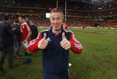 Rob Howley the Lions attack coach celebrates after their victory during the First Test match between the Australian Wallabies and the British Irish...