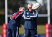 Rob Howley the Lions attack coach passes the ball watched by head coach Warren Gatland during the British and Irish Lions captain's run at Scotch...