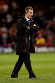 Rob Howley the Wales Interim Head Coach watches over the warmup prior to kickoff during the RBS Six Nations match between Wales and England at...