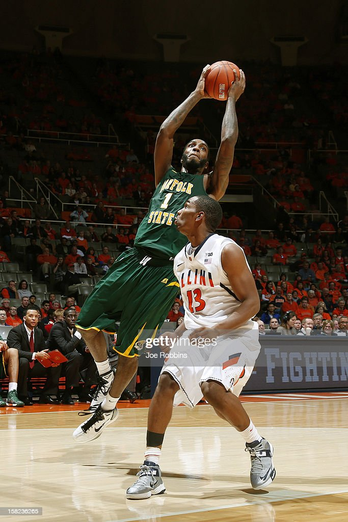 Rob Johnson #1 of the Norfolk State Spartans goes to the basket against Tracy Abrams #13 of the Illinois Fighting Illini during the game at Assembly Hall on December 11, 2012 in Champaign, Illinois. Illinois won 64-54.