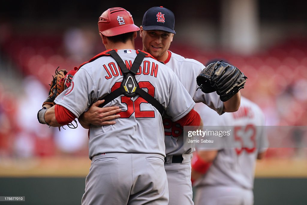 Rob Johnson #32 of the St. Louis Cardinals congratulates pitcher <a gi-track='captionPersonalityLinkClicked' href=/galleries/search?phrase=Trevor+Rosenthal&family=editorial&specificpeople=9003011 ng-click='$event.stopPropagation()'>Trevor Rosenthal</a> #26 after the Cardinals defeated the Cincinnati Reds 15-2 at Great American Ball Park on August 4, 2013 in Cincinnati, Ohio.