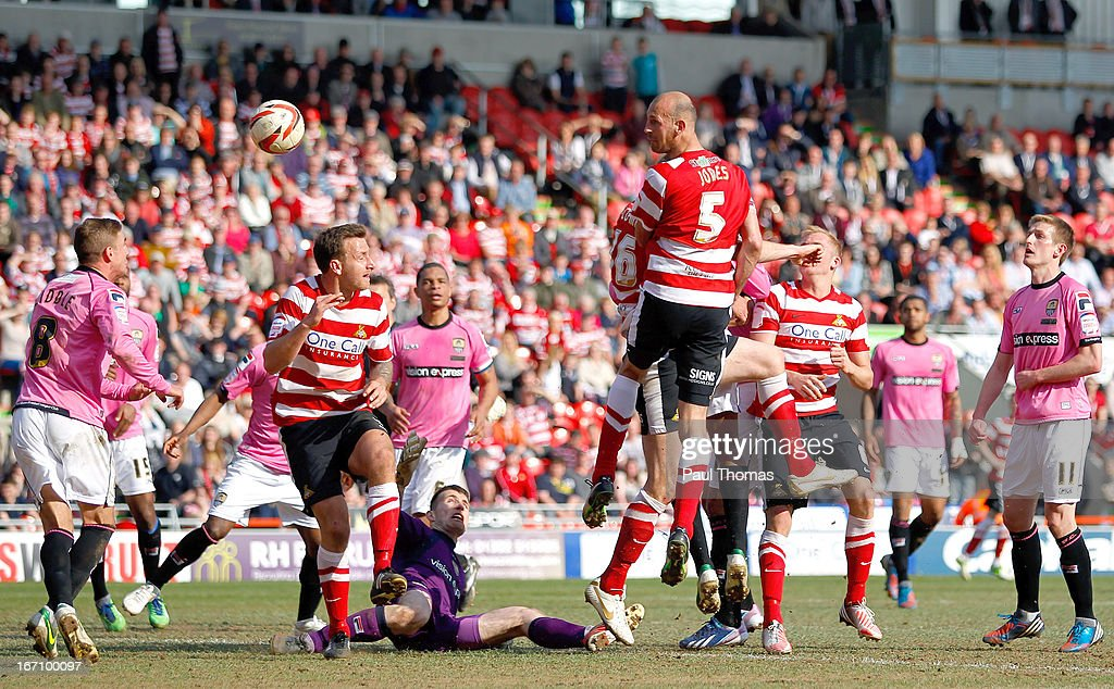 Rob Jones (C) of Doncaster headers at goal during the npower League One match between Doncaster Rovers and Notts County at the Keepmoat Stadium on April 20, 2013 in Doncaster, England.