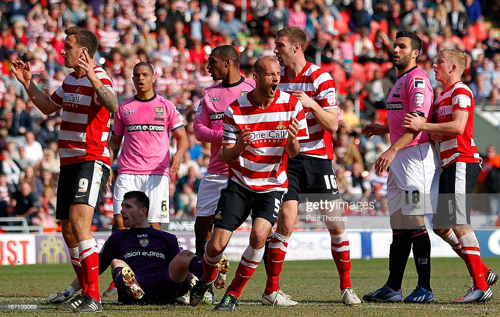 Rob Jones (C) of Doncaster reacts after missing a goal scoring chance during the npower League One match between Doncaster Rovers and Notts County at the Keepmoat Stadium on April 20, 2013 in Doncaster, England.
