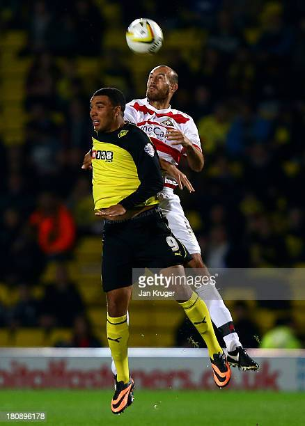 Rob Jones of Doncaster Rovers and Troy Deeney of Watford competes for the arial ball during the Sky Bet Championship match between Watford and...