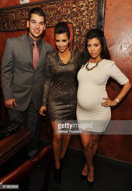 Rob Kardashian Kim Kardashian and Kourtney Kardashian attend TAO Bistro at the Venetian on October 16 2009 in Las Vegas Nevada