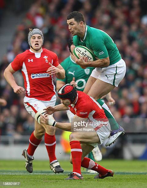 Rob Kearney of Ireland catches the high ball despite the challenge from Leigh Halfpenny during the RBS Six Nations match between Ireland and Wales at...