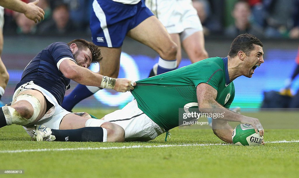Rob Kearney of Ireland dives over for a try during the RBS Six Nations match between Ireland and Scotland at the Aviva Stadium on February 2, 2014 in Dublin, Ireland.