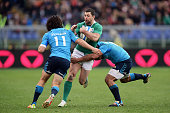 Rob Kearney of Ireland is halted by Luke McLean of Italy and Kelly Haimona of Italy during the RBS Six Nations match between Italy and Ireland at the...