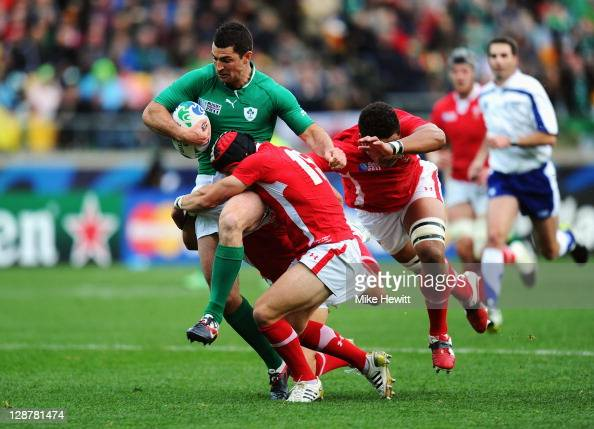 Rob Kearney of Ireland is tackled by Mike Phillips Leigh Halfpenny and Toby Faletau of Wales during quarter final one of the 2011 IRB Rugby World Cup...