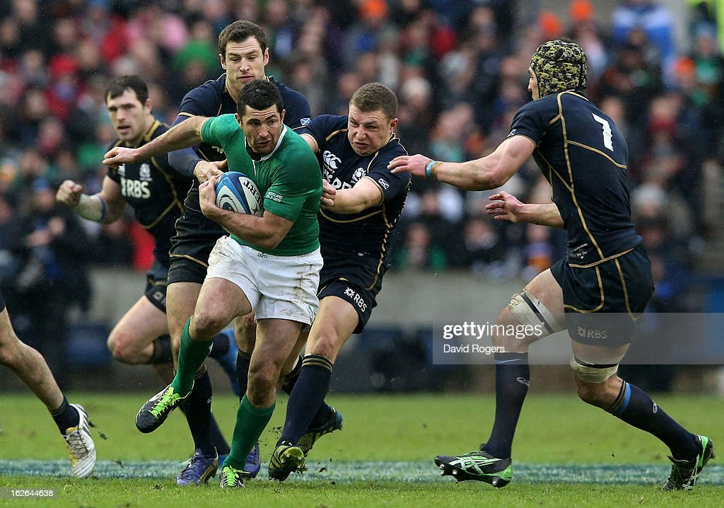 Rob Kearney of Ireland is tackled by Tim Visser, Duncan Weir and Kelly Brown of Scotland during the RBS Six Nations match between Scotland and Ireland at Murrayfield Stadium on February 24, 2013 in Edinburgh, Scotland.