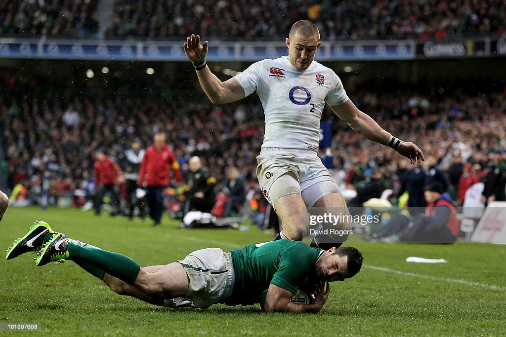 Rob Kearney of Ireland throws himself on the loose ball metres from his tryline as Mike Brown of England closes in during the RBS Six Nations match between Ireland and England at Aviva Stadium on February 10, 2013 in Dublin, Ireland.