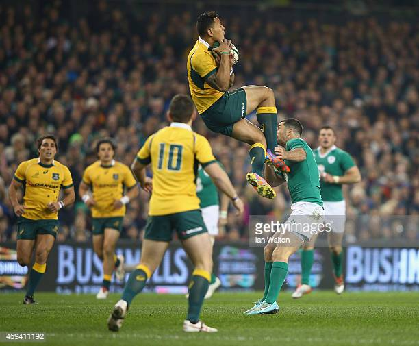 Rob Kearney of Ireland tries to tackle Israel Folau of Australia during the international friendly match between Ireland and Australia at Aviva...