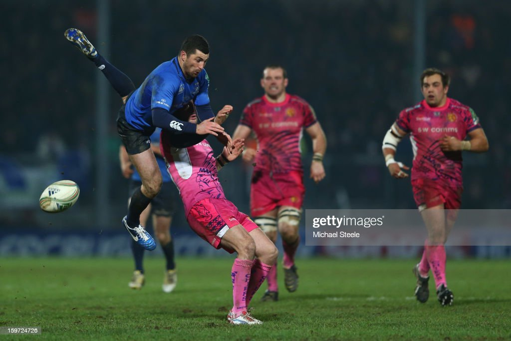 Rob Kearney (L) of Leinster knocks on from a high ball under the challenge of <a gi-track='captionPersonalityLinkClicked' href=/galleries/search?phrase=Luke+Arscott&family=editorial&specificpeople=2350778 ng-click='$event.stopPropagation()'>Luke Arscott</a> of Exeter Chiefs during the Heineken Cup Pool Five match between Exeter Chiefs and Leinster at Sandy Park on January 19, 2013 in Exeter, England.