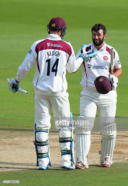 Rob Keogh of Northamptonshire congratulates David Murphy of Northamptonshire on reaching his maiden first class 100 during the LV County Championship...