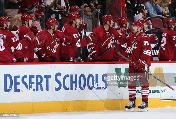 Rob Klinkhammer of the Arizona Coyotes celebrates with teammates on the bench after scoring against the San Jose Sharks during the preseason NHL game...