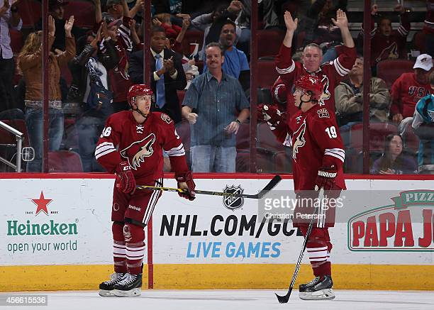 Rob Klinkhammer of the Arizona Coyotes reacts alongside Shane Doan after Klinkhammer scored a third period goal against the San Jose Sharks during...