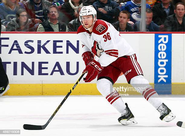 Rob Klinkhammer of the Arizona Coyotes skates up ice with the puck during their NHL game against the Vancouver Canucks at Rogers Arena November 14...