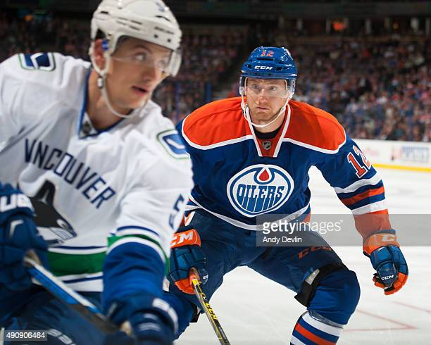 Rob Klinkhammer of the Edmonton Oilers battles for the puck during a preseason game against the Vancouver Canucks on October 1 2015 at Rexall Place...