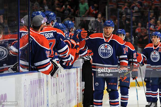 Rob Klinkhammer of the Edmonton Oilers celebrates with team mates after scoring a goal during a game against the Washington Capitals on October 23...