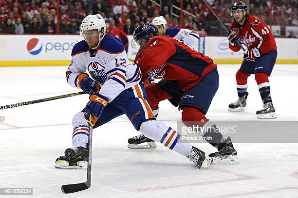 Rob Klinkhammer of the Edmonton Oilers eludes Jay Beagle of the Washington Capitals in the third period at Verizon Center on January 20 2015 in...
