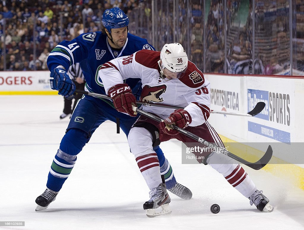 Rob Klinkhammer #36 of the Phoenix Coyotes gets tied up by Andrew Alberts #41 of the Vancouver Canucks during the second period in NHL action on April 08, 2013 at Rogers Arena in Vancouver, British Columbia, Canada.